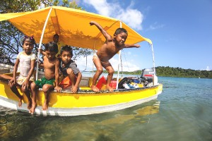 Panamanian Children on a Fishing Boat shot by David Evanko